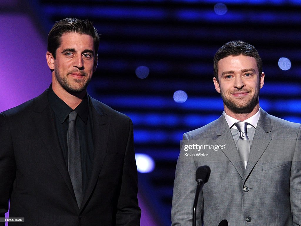 NFL player Aaron Rodgers and actor Justin Timberlake present the ESPY for Best Male College Athlete during The 2011 ESPY Awards at Nokia Theatre L.A. Live on July 13, 2011 in Los Angeles, California.