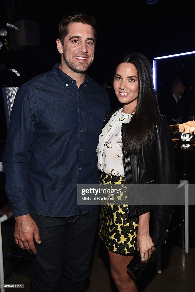 NFL player Aaron Rodgers (L) and actress Olivia Munn attend the Samsung Galaxy S 6 edge launch on April 2, 2015 in Los Angeles, California.