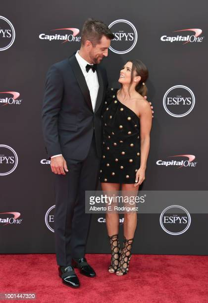 NFL player Aaron Rodgers and host Danica Patrick attend The 2018 ESPYS at Microsoft Theater on July 18 2018 in Los Angeles California