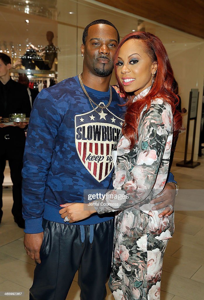 Player Aaron Ross and Olympic Track & Field Champion Sanya Richards-Ross attend a cocktail reception hosted by Saks Fifth Avenue And Off The Field Players' Wives Association on January 30, 2014 in New York City.