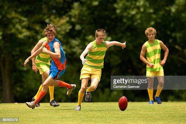 Player about to kick an Australian football