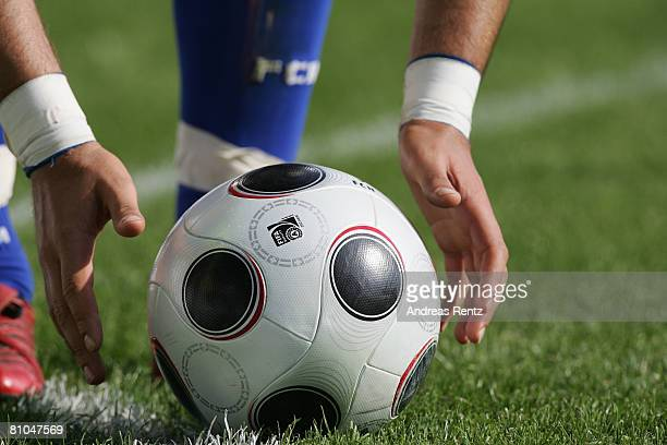 A player adjusts the ball during the Bundesliga match between Hansa Rostock and Bayer Leverkusen at the DKB Arena on May 10 2008 in Rostock Germany