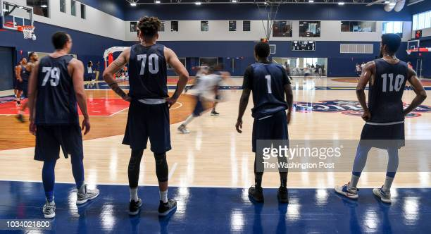 Player Adrian Knoth Stephan Bennett Darian Anderson and Donald Vaughn wait their turn to play during open tryouts for the Capital City GoGo the...