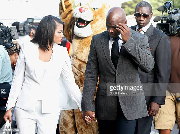 NFL player Adrian Peterson of the Minnesota Vikings walks with his wife Ashley Brown to a court appearance at the Montgomery County municipal...