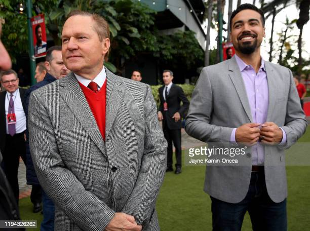 Player agent Scott Boras arrives with Anthony Rendon of the Los Angeles Angels for an introductory press conference at Angel Stadium of Anaheim on...