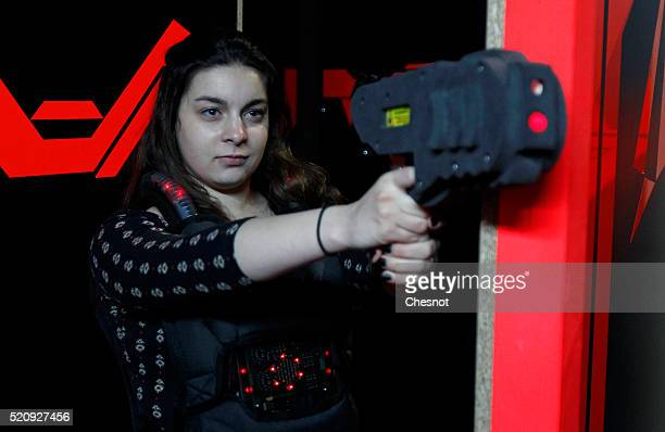 A player aims with a laser gun in a games centre 'Laser Game Evolution' on April 13 2016 in BretignysurOrge France Laser Game Evolution the French...