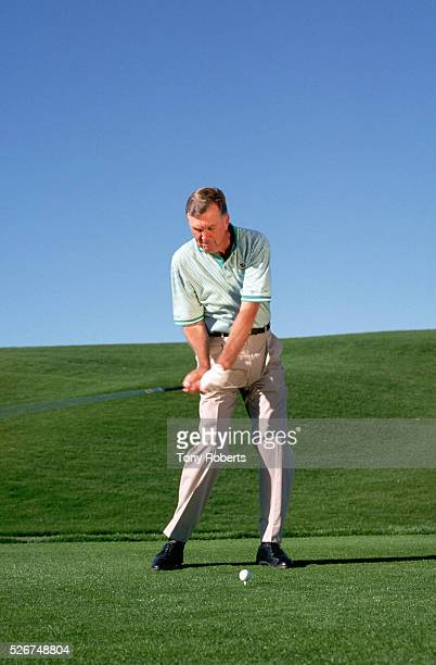 SPGA player Al Geiberger swings at a golf ball on a golf course in Palm Desert