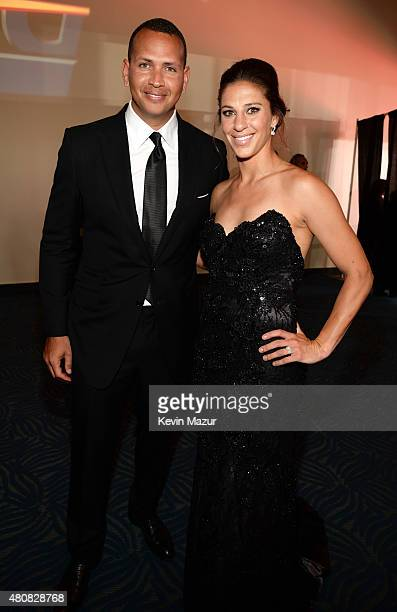MLB player Alex Rodriguez with USWNT soccer player Carli Lloyd attend The 2015 ESPYS at Microsoft Theater on July 15 2015 in Los Angeles California
