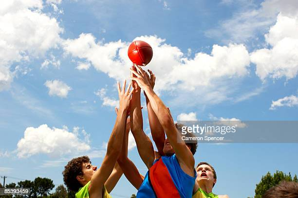 player all jumping to catch australian football - afl stock pictures, royalty-free photos & images