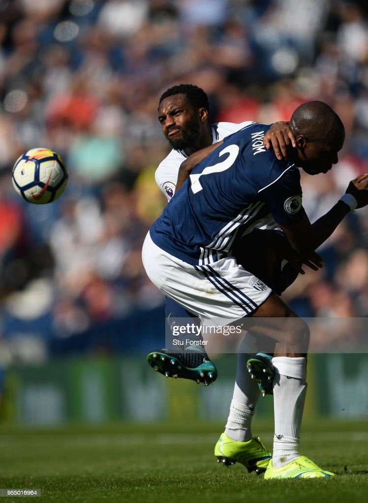 WBA player Allan Nyom (r) challenges Danny Rose of Spurs during the Premier League match between West Bromwich Albion and Tottenham Hotspur at The Hawthorns on May 5, 2018 in West Bromwich, England.