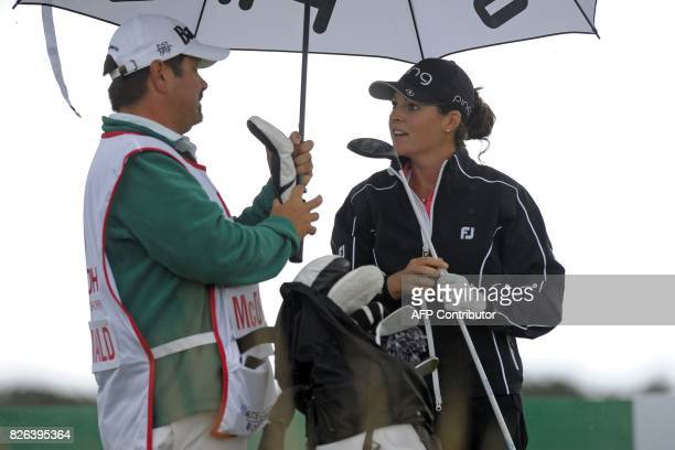 US player Ally McDonald talks to her caddie the 16th tee during her second round on day 2 of the 2017 Women's British Open Golf Championship at...
