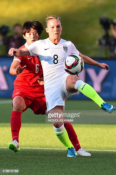 US player Amy Rodriguez kicks the ball past China's Li Dongna during a 2015 FIFA Women's World Cup quarterfinal match between the US and China at...