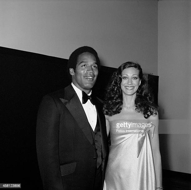 NFL player and actor OJ Simpson and actress Marisa Berenson pose for a portrait before presenting for Short Film on March 29 1976 at the Dorothy...