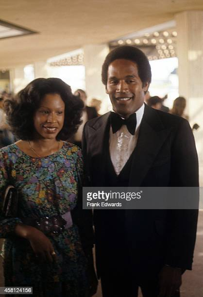 NFL player and actor OJ Simpson and wife Marguerite Simpson pose for a portrait at a movie premiere in April 1977 in Los Angeles California