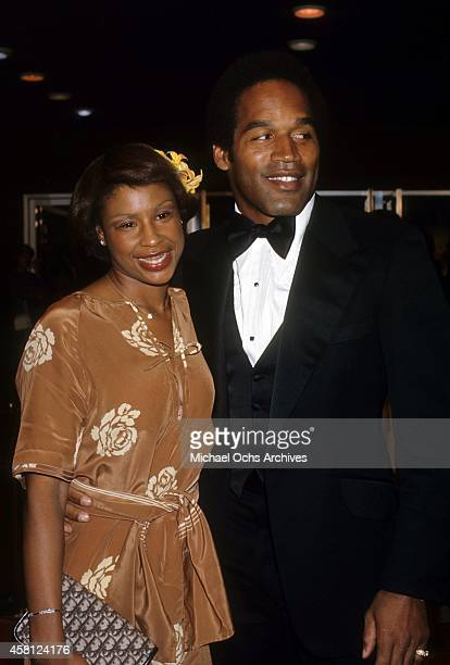 NFL player and actor OJ Simpson and wife Marguerite Simpson pose for a portrait at a movie premiere in 1977 in Los Angeles California