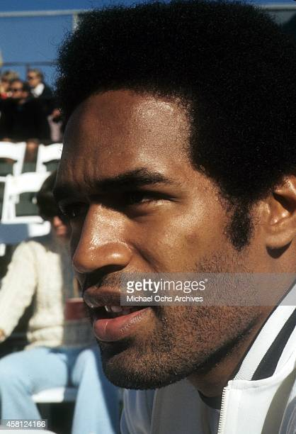 NFL player and actor OJ Simpson poses for a portrait during a tennis charity event in January 1973 in Los Angeles California
