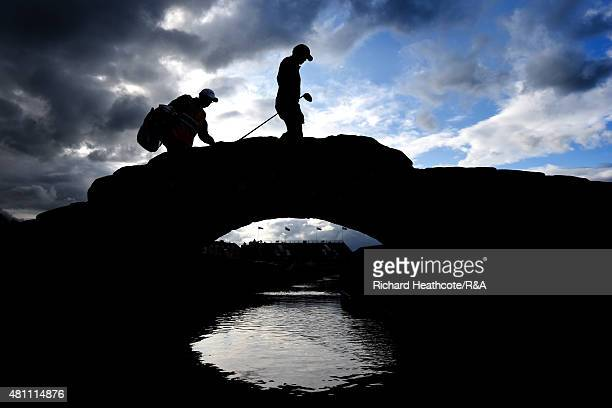A player and caddy cross the Swilcan Bridge during the second round of the 144th Open Championship at The Old Course on July 17 2015 in St Andrews...
