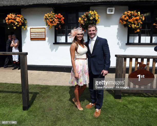 Player and race horse owner Wes Welker with wife Anna Burns during the Darley July Cup Day of the July Festival at Newmarket Racecourse.