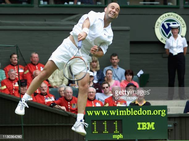 US player Andre Agassi serves during his second round match against Britain's Jamie Delgado at the All England Tennis Championships in Wimbledon 28...