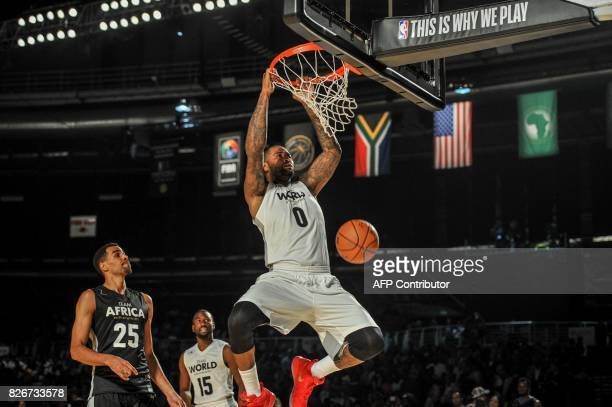Player Andre Drummond from the Detriot Pistons slam dunks during the NBA Africa Game 2017 basketball match between Team Africa and Team World on...