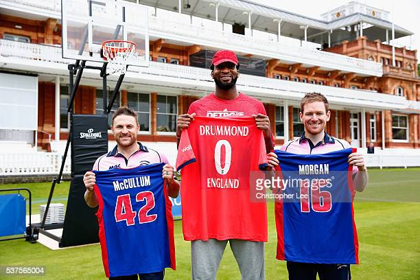 NBA player Andre Drummond meets Middlesex Cricketers Eoin Morgan of England and Brendan McCullum of New Zealand at Lords on June 2 2016 in London...
