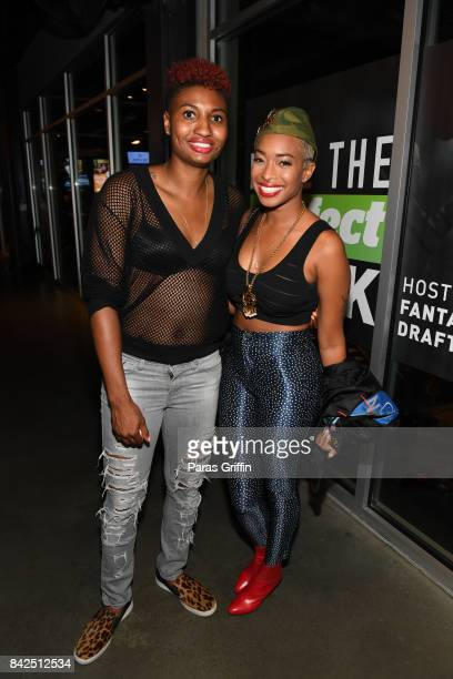 Player Angel McCoughtry and Brande Elise at LudaDay Weekend Topgolf Takeover at Topgolf Midtown on September 3 2017 in Atlanta Georgia
