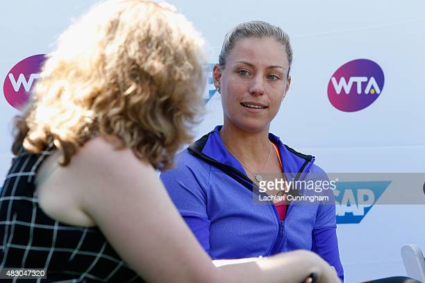 WTA player Angelique Kerber speaks on a panel at a press conference for SAP during day three of the Bank of the West Classic at the Stanford...