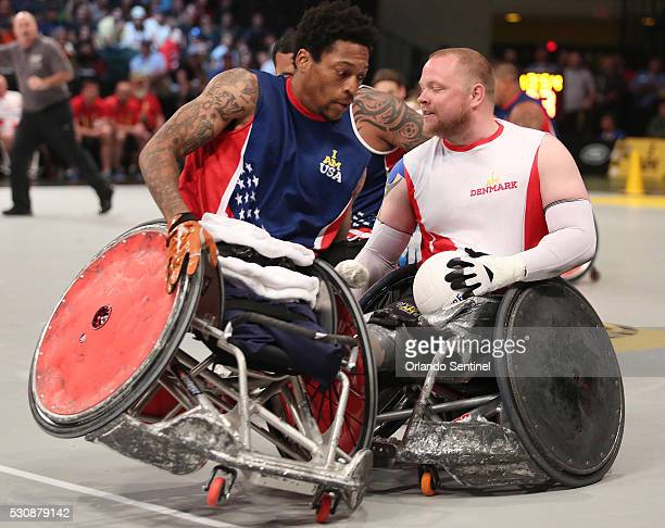 USA player Anthony McDaniel LEFT collides with Denmark'S Mark Peters RIGHT during the gold medal wheelchair rugby gold medal match at the Invictus...