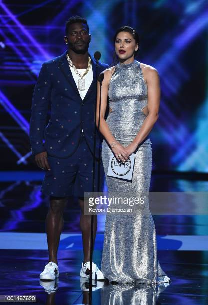 NFL player Antonio Brown and soccer player Alex Morgan speak onstage at The 2018 ESPYS at Microsoft Theater on July 18 2018 in Los Angeles California
