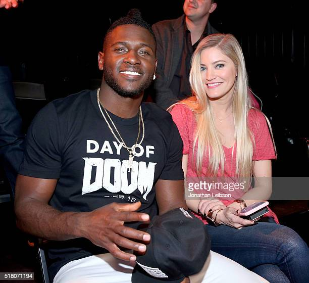 Player Antonio Brown and YouTube influencer Justine Ezarik attend as athletes and YouTube stars team for DOOM Videogame Tournament at Siren Studios...