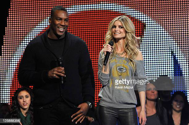 NFL player Antonio Gates and model Marisa Miller speak onstage during VH1's Pepsi Super Bowl Fan Jam at Verizon Theater on February 3 2011 in Grand...