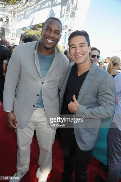 NFL player Antonio Gates and TV Personality Mario Lopez arrive at the 2012 MTV Movie Awards held at Gibson Amphitheatre on June 3 2012 in Universal...