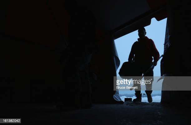 A player arrives to the changing tent prior to the start of the 2013 USA Hockey Pond Hockey National Championships on February 10 2013 in Eagle River...