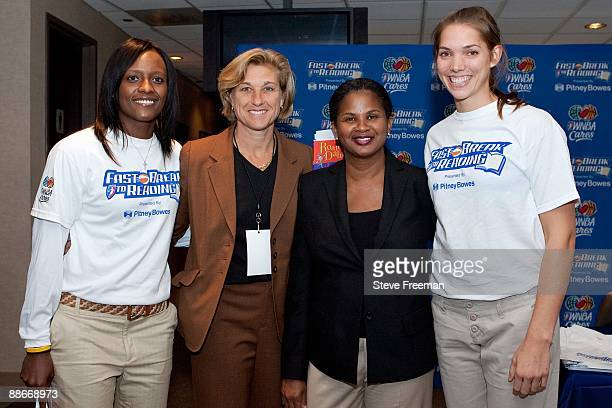 Player Ashley Battle General Manager Carol Blazejowski and Sidney Spencer of the New York Liberty pose for a portrait during the New York Liberty...