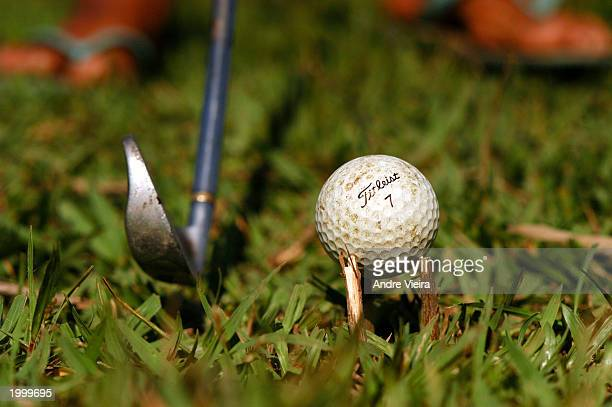 A player at Japeri Municipal Public Golf Course uses grass sticks to improvise tee May 14 2003 in Rio de Janeiro suburb of Japeri The golf course was...