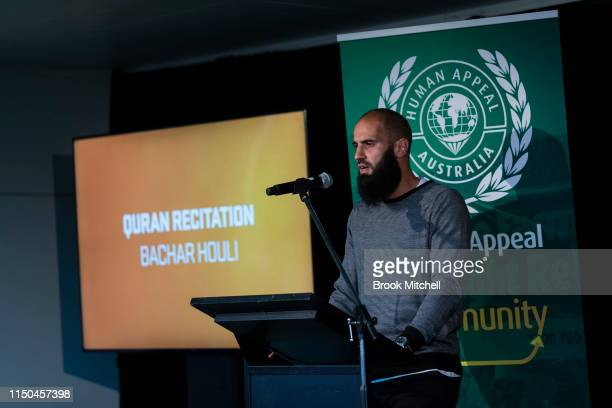 AFL player Bachar Houli is pictured reciting the Quran on May 20 2019 in Sydney Australia The annual Iftar dinner hosted by the Giants aims to bring...