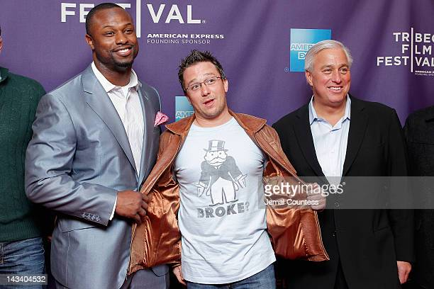 NFL player Bart Scott director Billy Corben and Ed Butowsky attend the Broke Premiere during the 2012 Tribeca Film Festival at the AMC Village 7 on...
