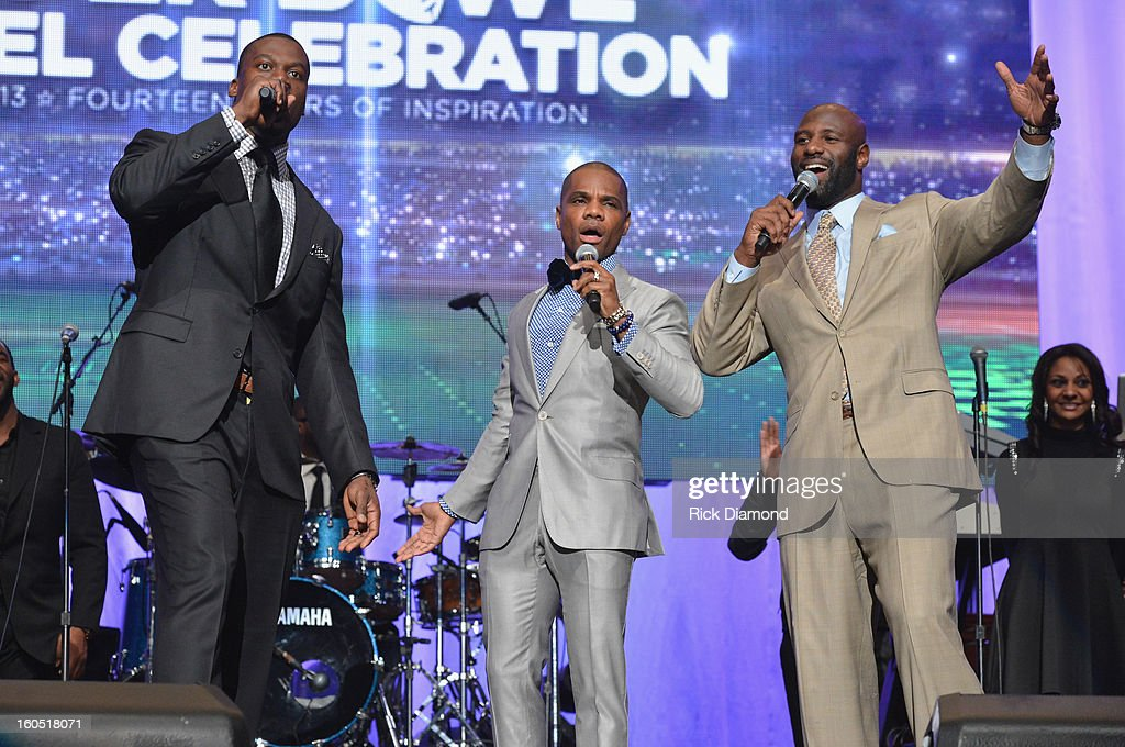 NFL player Benjamin Watson, host Kirk Franklin and NFL player Bryant McKinnie speak onstage during the Super Bowl Gospel 2013 Show at UNO Lakefront Arena on February 1, 2013 in New Orleans, Louisiana.