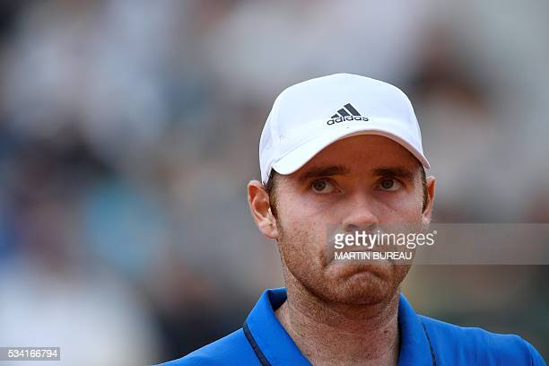 Player Bjorn Fratangelo reacts during his men's second round match against France's Richard Gasquet at the Roland Garros 2016 French Tennis Open in...