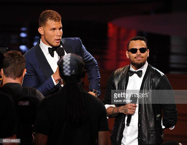 NBA player Blake Griffin and singer Chris Brown speak onstage during the 2014 ESPYS at Nokia Theatre LA Live on July 16 2014 in Los Angeles California