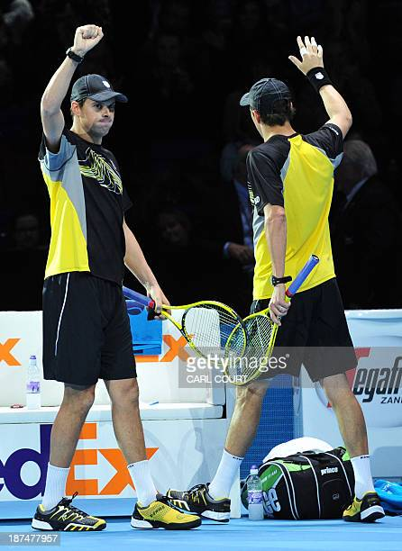 US player Bob Bryan and his partner US player Mike Bryan celebrate beating Poland's Marcin Matkowski and his partner Poland's Mariusz Fyrstenberg...