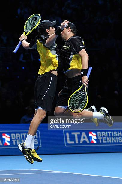 US player Bob Bryan and his partner US player Mike Bryan do their trademark chest bump celebration after beating Poland's Marcin Matkowski and his...