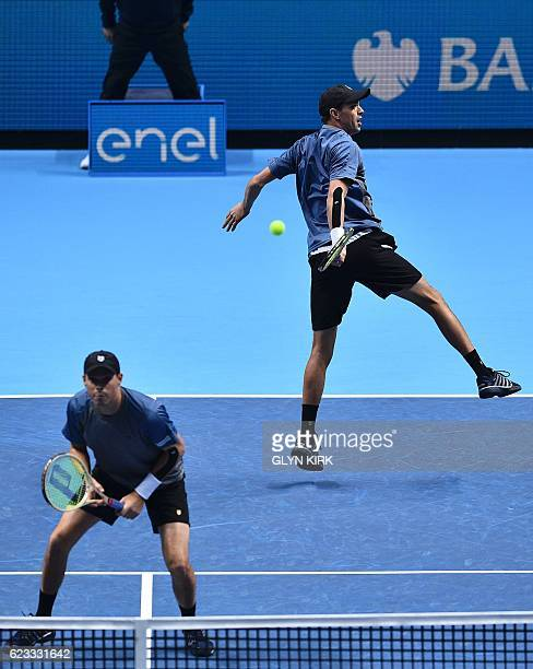US player Bob Bryan covers the net as his partner US player Mike Bryan returns against Brazil's Bruno Soares and Britain's Jamie Murray during their...