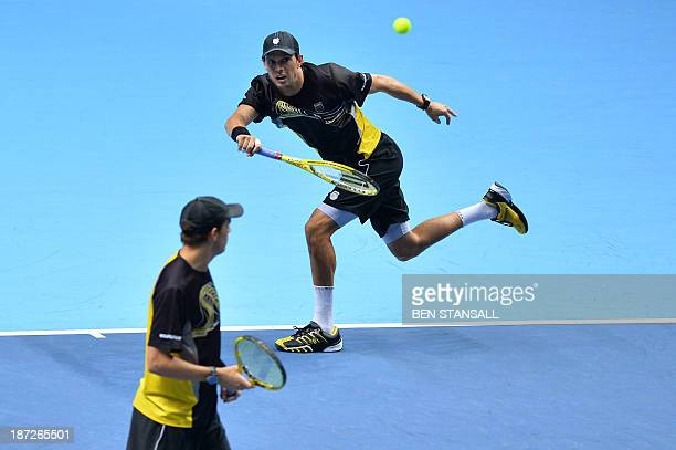 US player Bob Bryan stands by as his partner US player Mike Bryan hits a return against Pakistan's AisamUlHaq Qureshi and his partner Netherlands'...