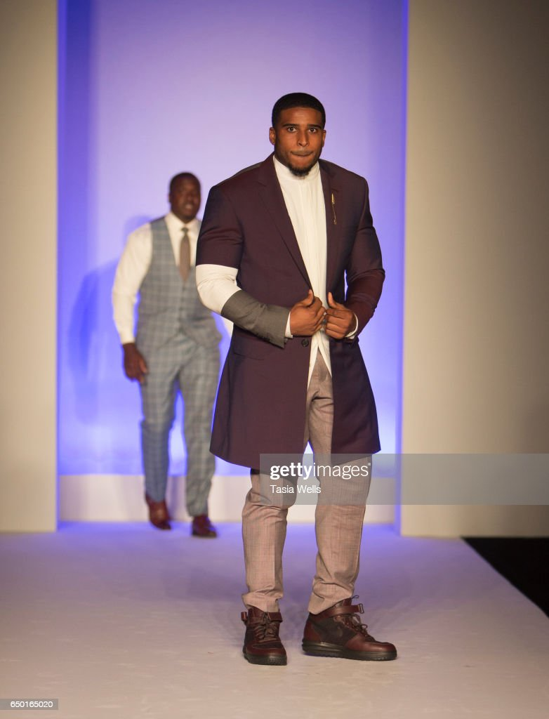NFL player Bobby Wagner walks the runway in Alba at the Fashion Setters Gala at the Beverly Wilshire Four Seasons Hotel on March 8, 2017 in Beverly Hills, California.