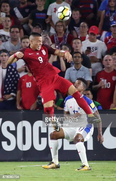 USA player Bobby Wood leaps high to head the ball over Panama's Luis Ovalle during World Cup qualifier match at Orlando City Stadium on Friday Oct 6...