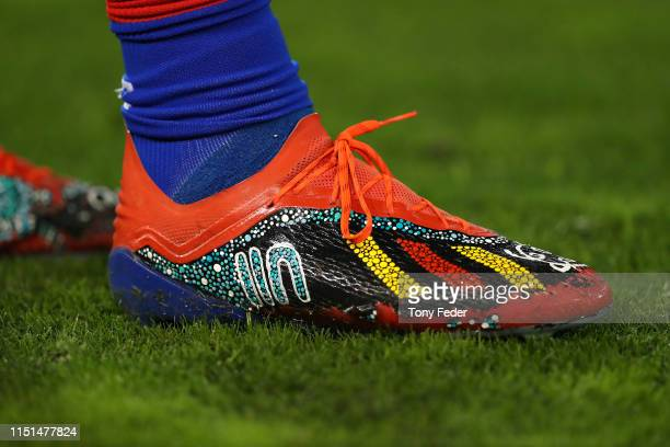 Player boots painted in traditional Aboriginal dots during the round 11 NRL match between the Newcastle Knights and the Sydney Roosters at McDonald...