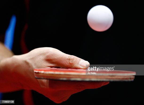 A player bounces a ball on his racquet before playing in the Men's Team Round One at the 15th Asian Games Doha 2006 at AlArabi Indoor Hall November...