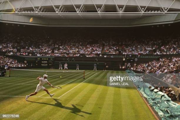 US player Bradley Klahn returns to Britain's Kyle Edmund in their men's singles second round match on the fourth day of the 2018 Wimbledon...