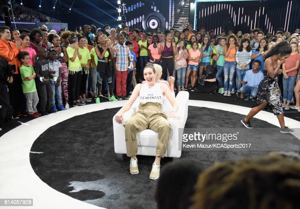 WNBA player Breanna Stewart and World Cup skiier Lindsey Vonn participate in the Beats N Seats competition during Nickelodeon Kids' Choice Sports...